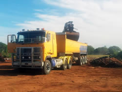 Semi-tipper loading truck